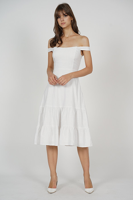 Dorcas Ruffled-Hem Dress in White - Arriving Soon