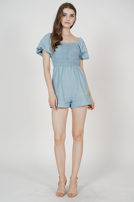 Gwyneth Smocked Denim Romper in Blue