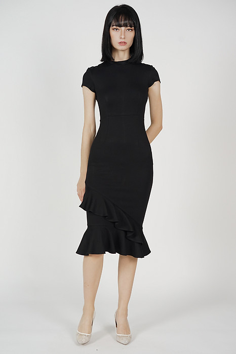 Jakelyn Asymmetrical Ruffled Hem Dress in Black - Arriving Soon