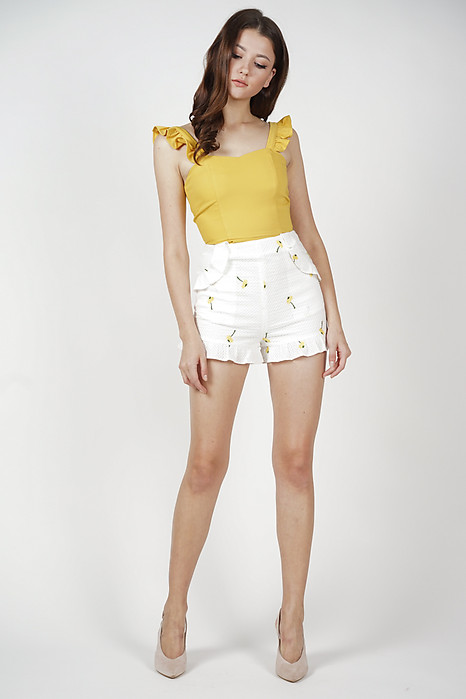 Daisie Ruffled Shorts in White - Arriving Soon