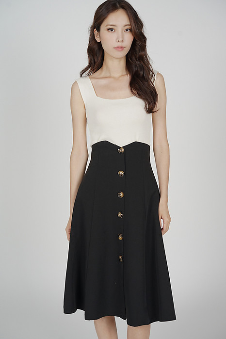 Aziel Buttoned Midi Skirt in Black - Arriving Soon