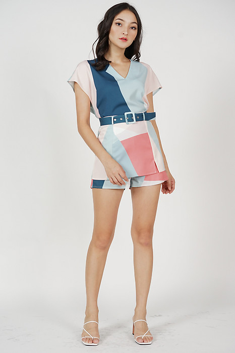 Kazan Geometric Overlay Buckled Skorts in Blue