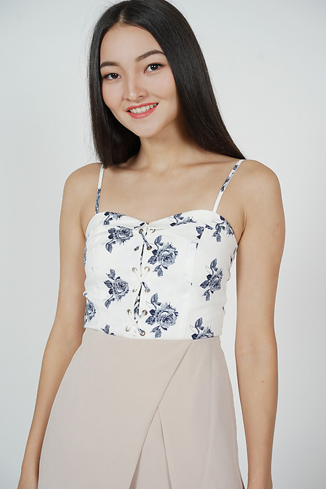 Oryn Lace-Up Peplum Top in White Floral
